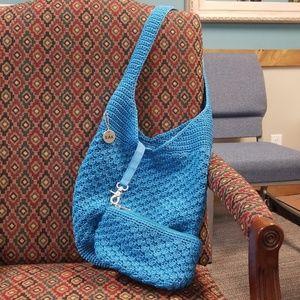 The Sak purse with makeup bag